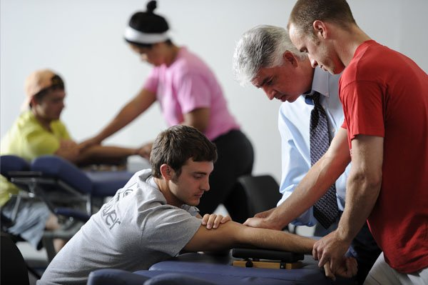 chiropractor teacher and student with patient
